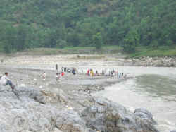 people taking bath in hot sulphur springs in Tattapani